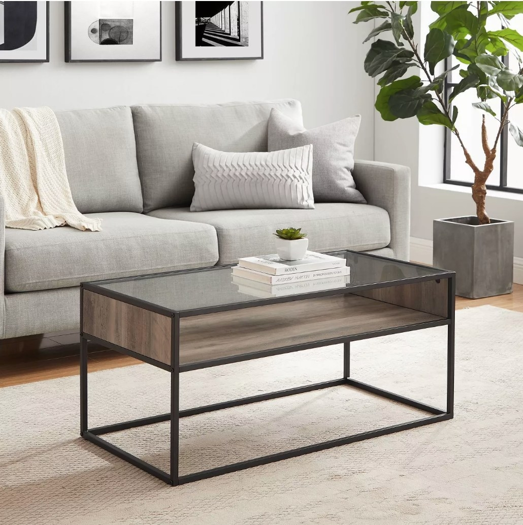 Ametal/glass coffee table in gray wash displayed in a living room