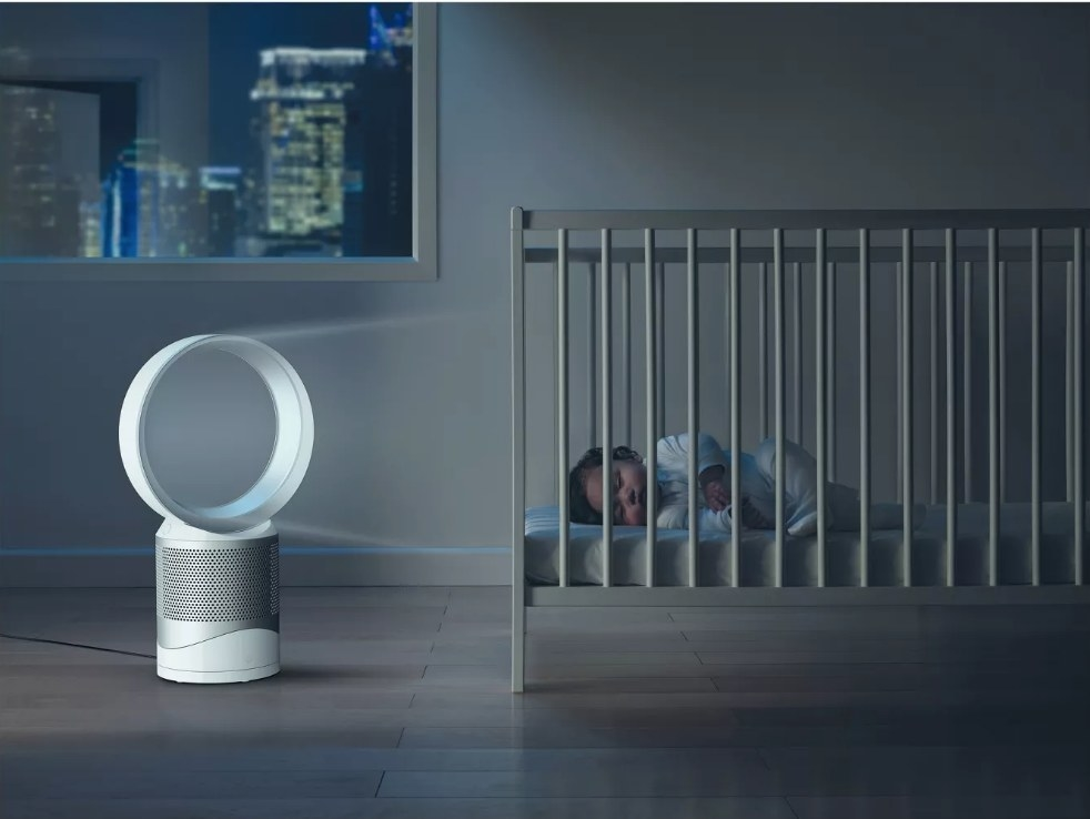 The Dyson air purifier and fan in white being used in a nursery