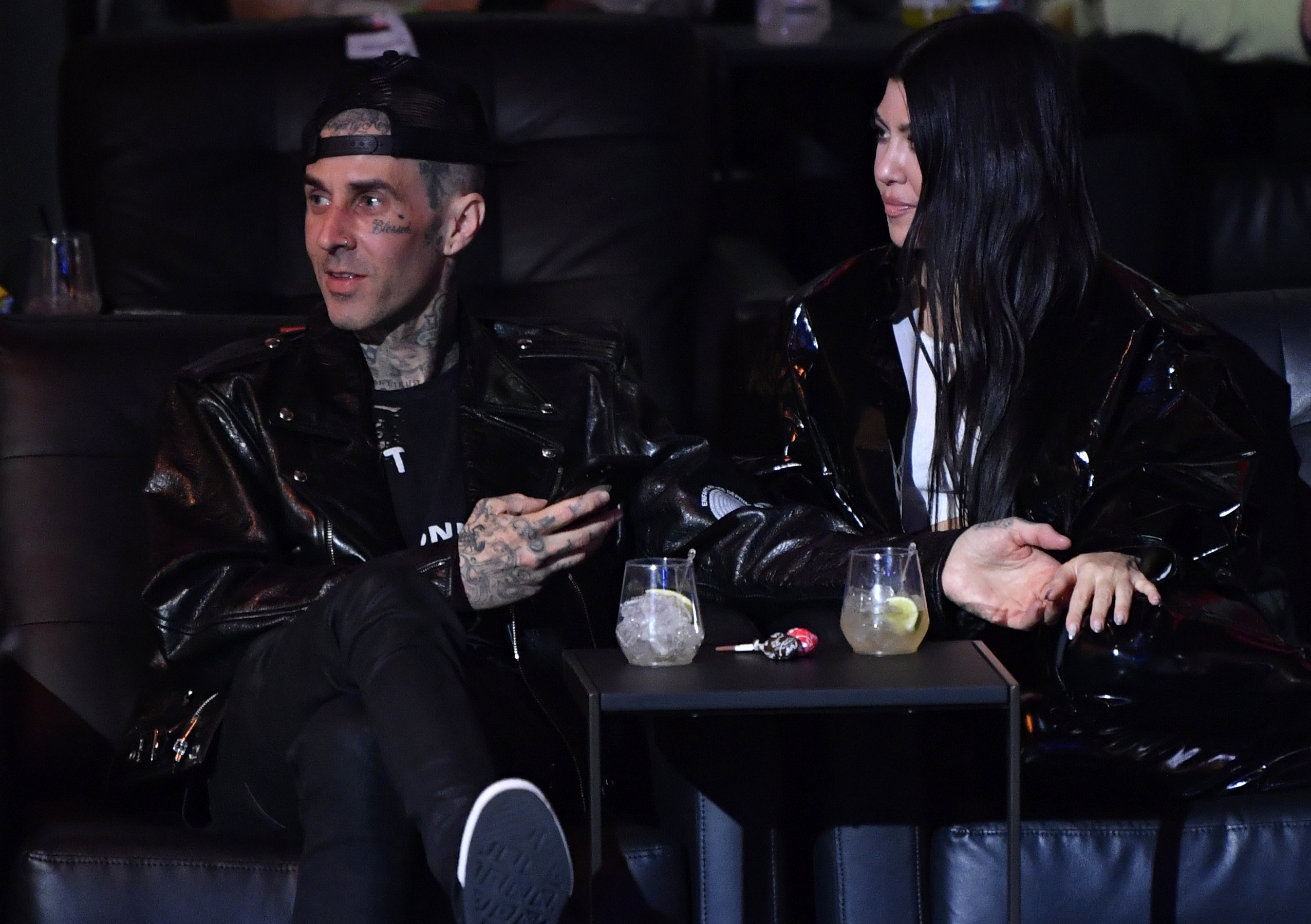 Travis Barker and Kourtney Kardashian are seen in attendance during the UFC 260 event at UFC APEX on March 27, 2021 in Las Vegas, Nevada