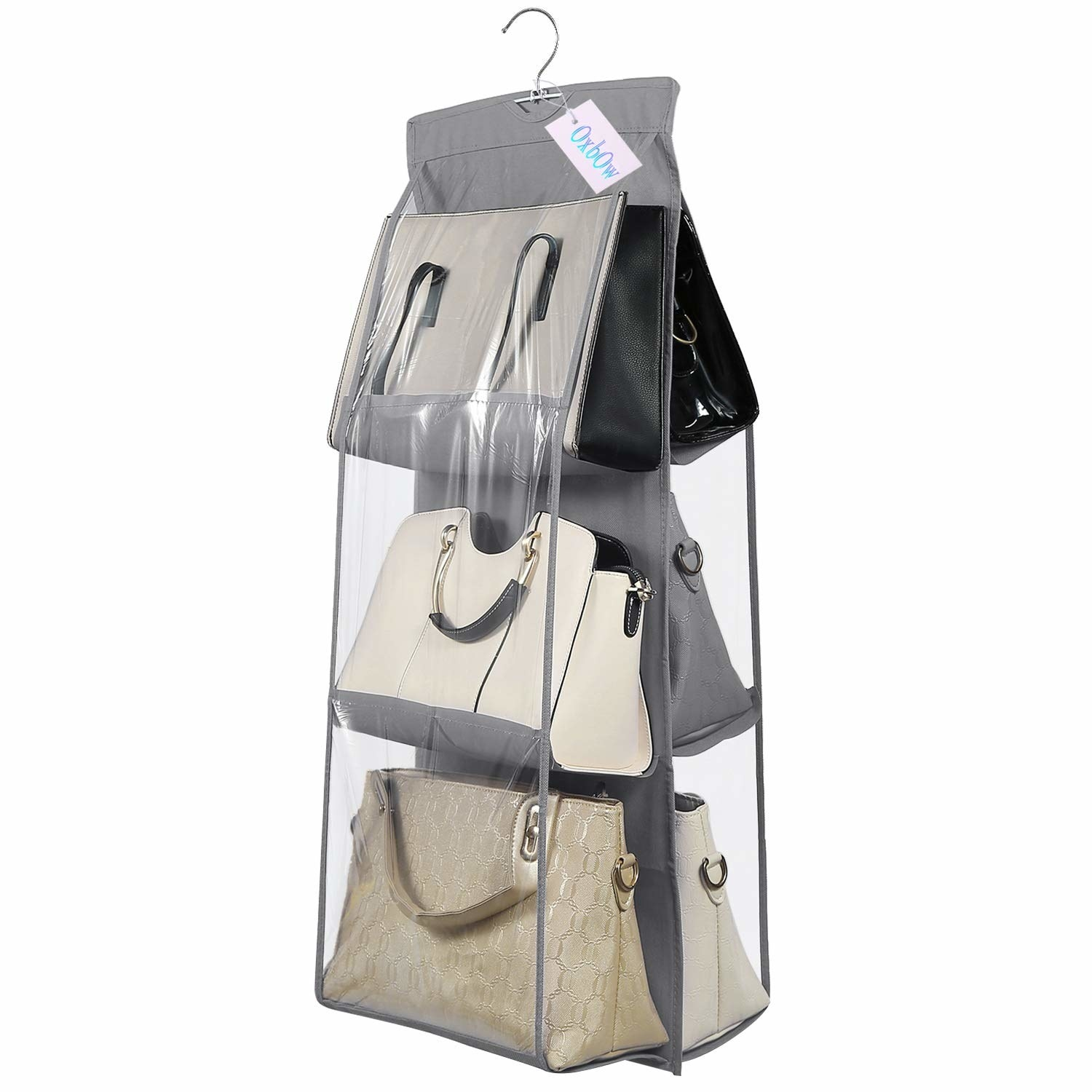 Grey hanging bag organiser. It comprises of large transparent pouches for storing handbags.