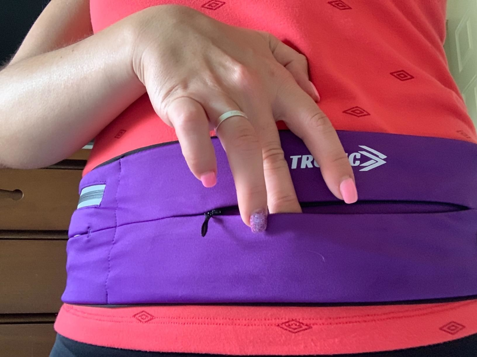 a reviewer wearing the running belt