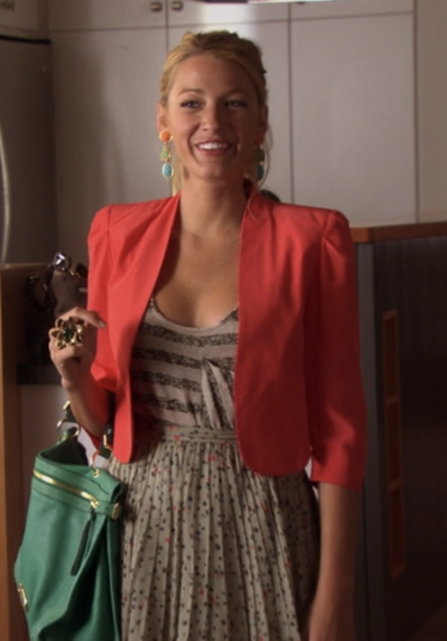 Serena in a pleated chiffon short high waisted mini floral pattern skirt with a striped tank and a bright 1/2 sleeve open blazer