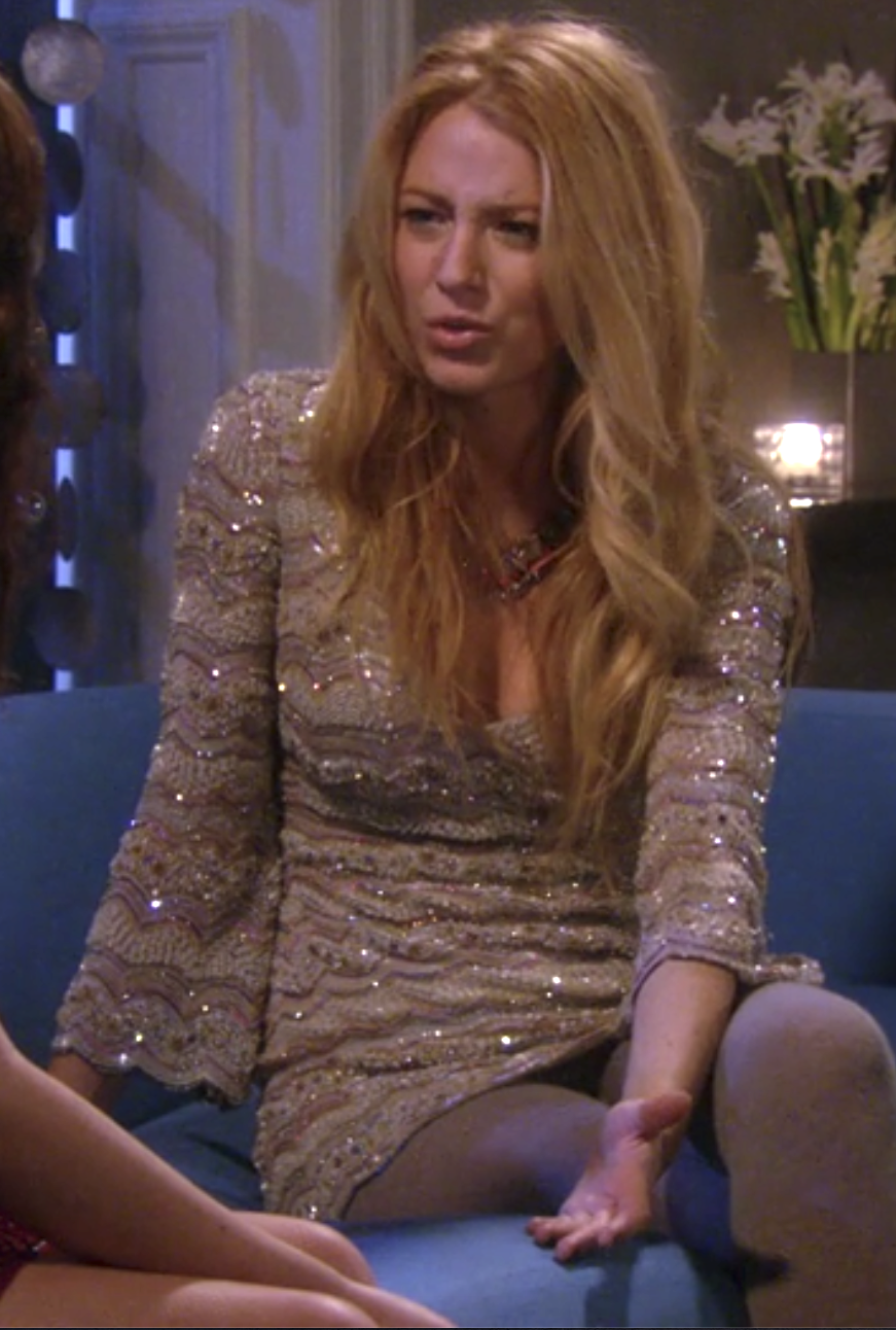 Serena in tights and a long flare sleeve v neck tight dress with scalloped lace and sequins