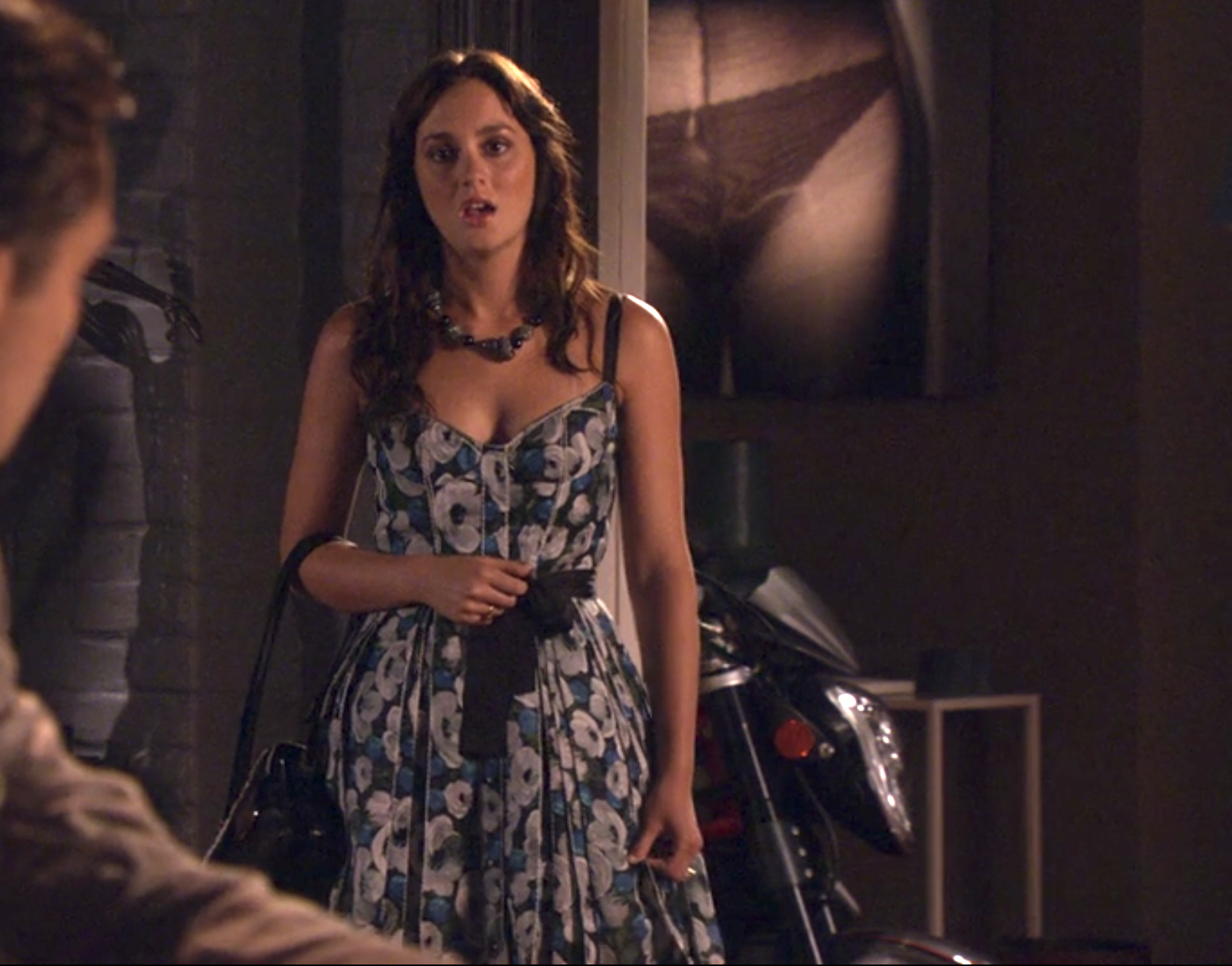 Blair in a sweetheart neckline tank floral pattern dress with a flare skirt and corset top and a tie at the waist