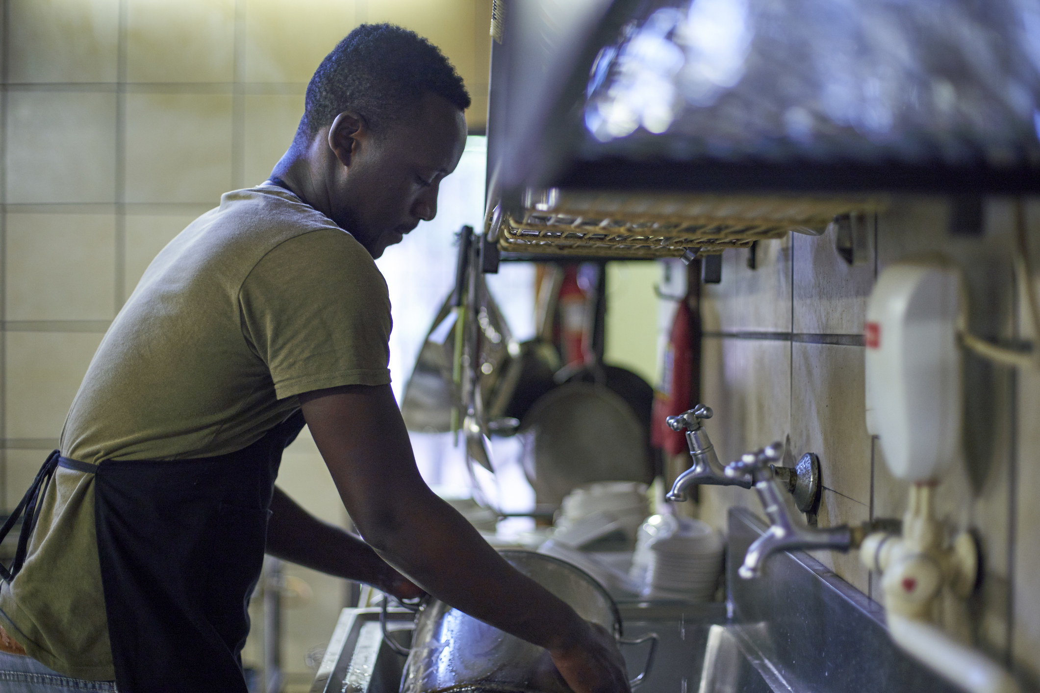 a person washing dishes