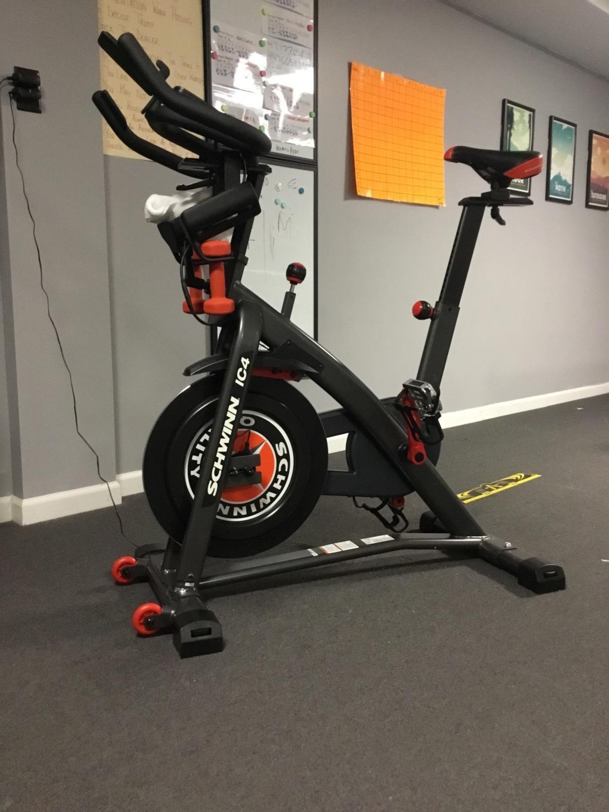 A reviewer's black and red bike with wheels for moving