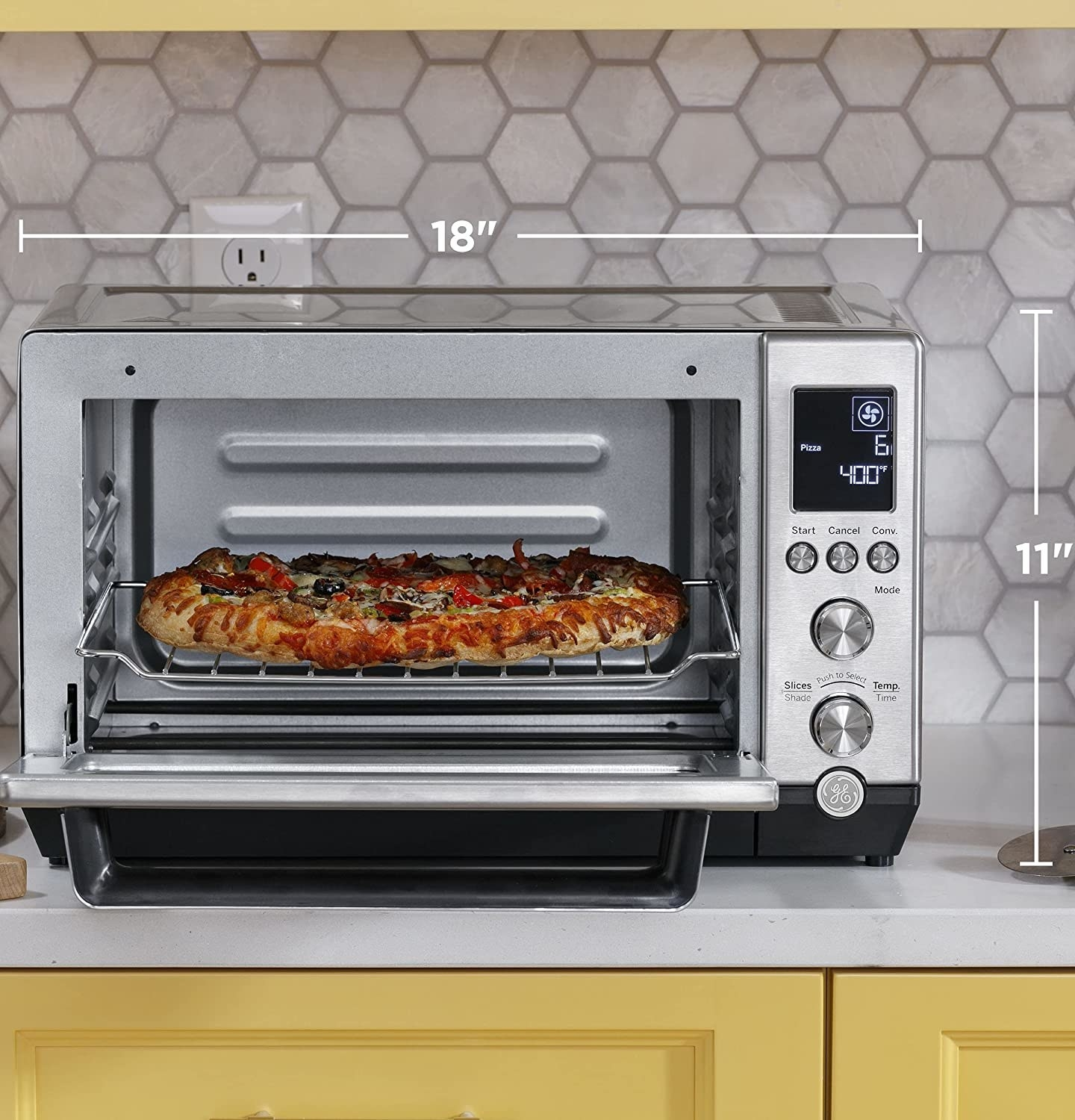 The stainless steel toaster oven with a drip tray and rack