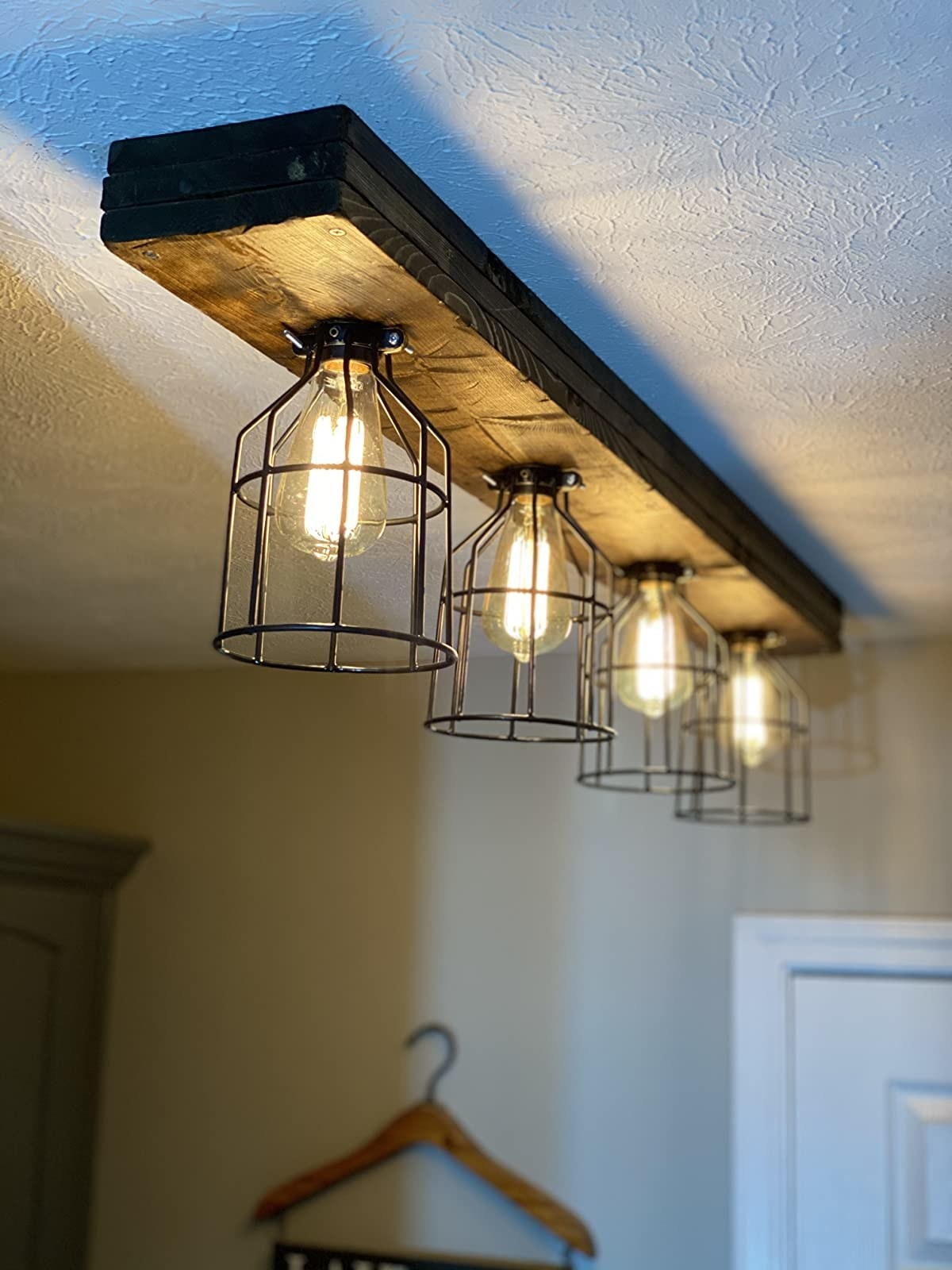 the four cage light fixtures