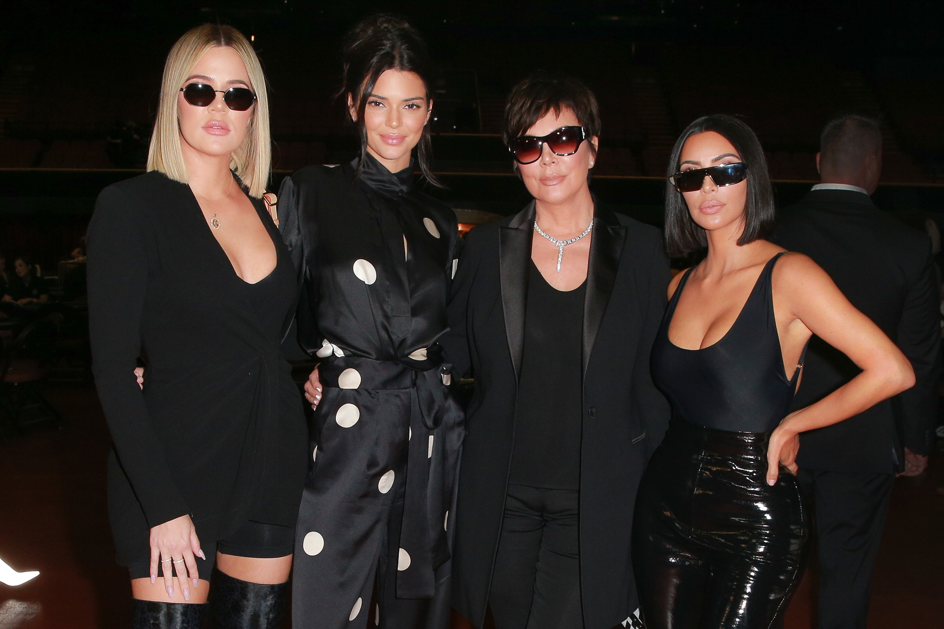 Khloé, Kendall, Kris, and Kim pose together in all black outfits