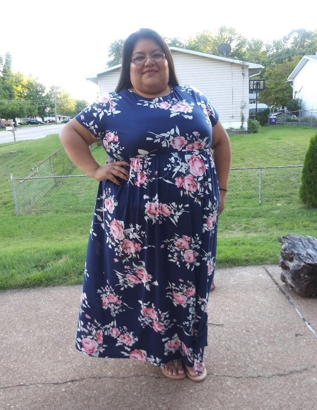 """A reviewer wearing a short sleeve, maxi dress with pockets in """"143navyprint"""""""