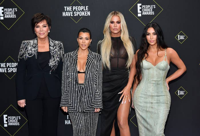 Kris, Kourtney, Khloe and Kim pose together at an event