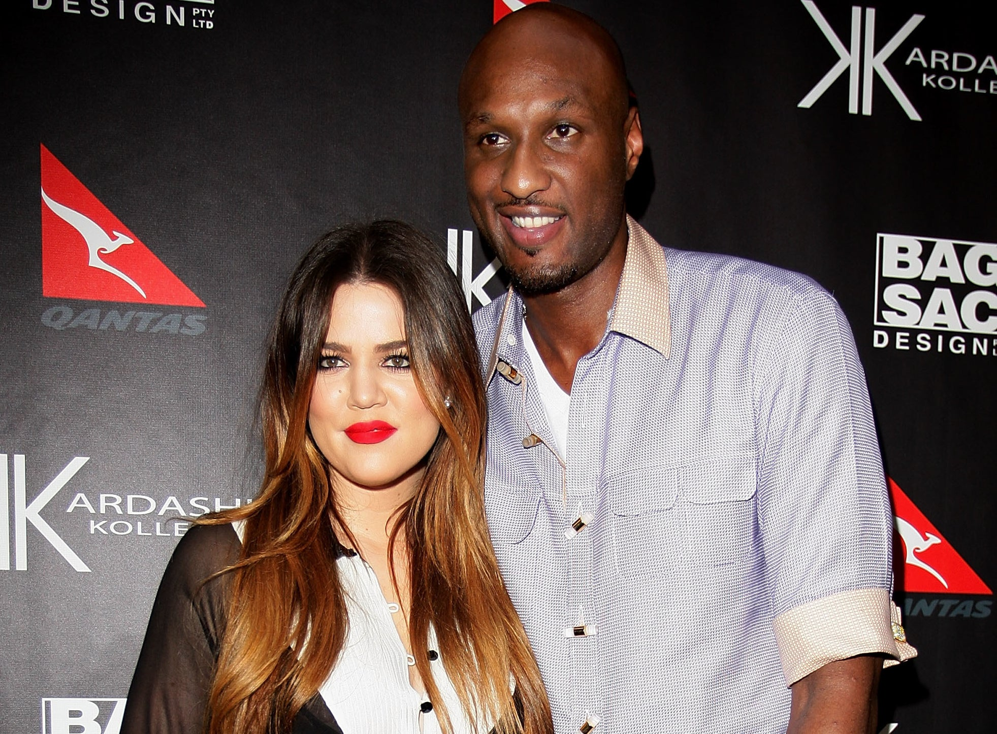 Khloé smiles next to Lamar in an old photo