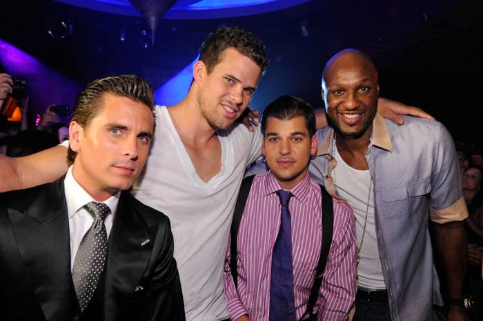Scott, Rob, Lamar, and Kris Humphries pose together at a club