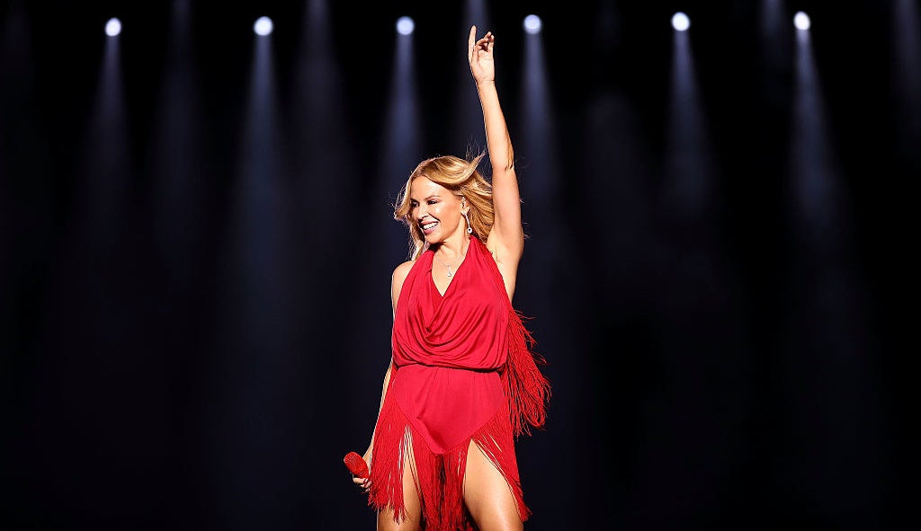 Kyle Minogue posing during a performance