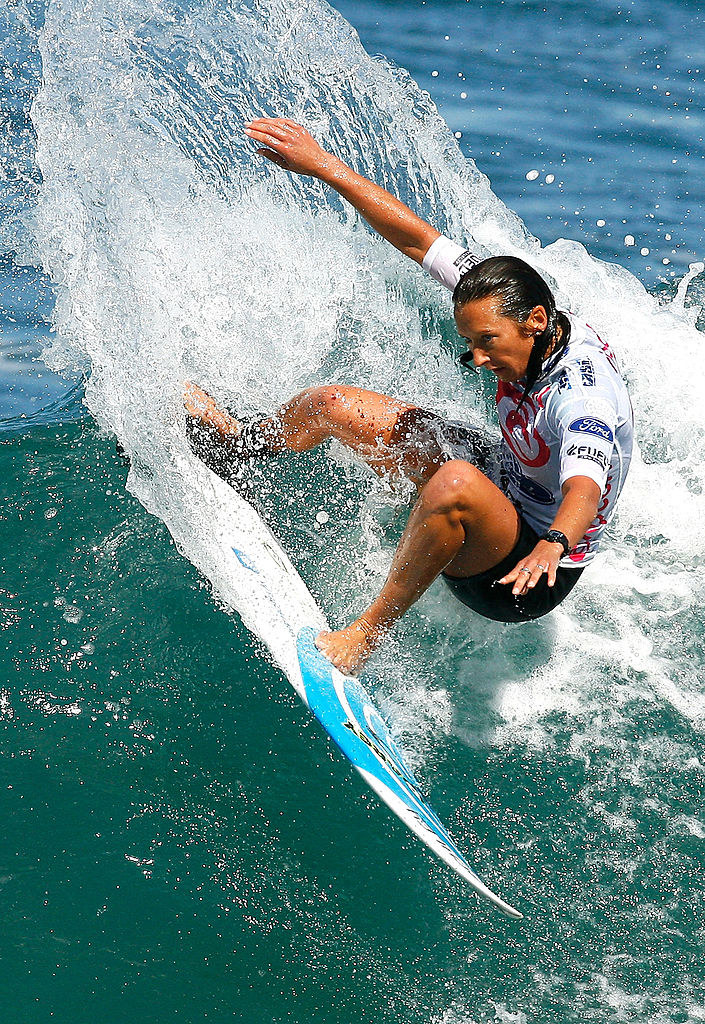 Layne Beachley, an Australian surfer, surfing a wave during a competition