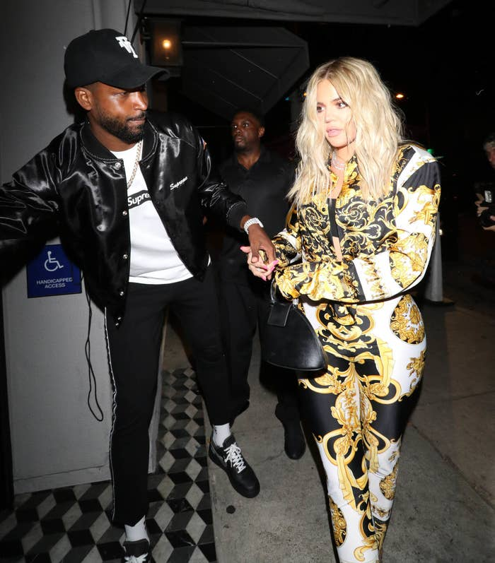 Tristan gets the door for Khloe outside a building in Los Angeles