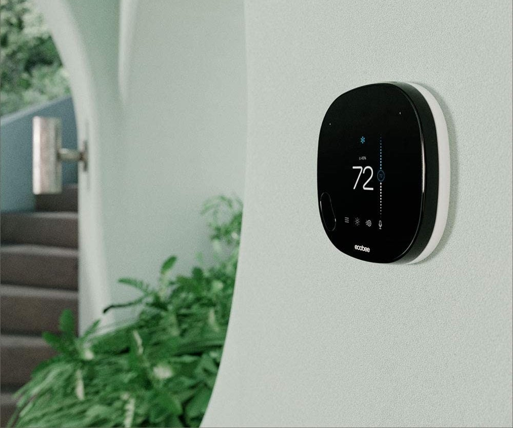 the thermostat displayed on a wall