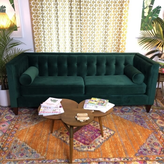 The couch with coffee table in front of it and a bohemian rug under the table