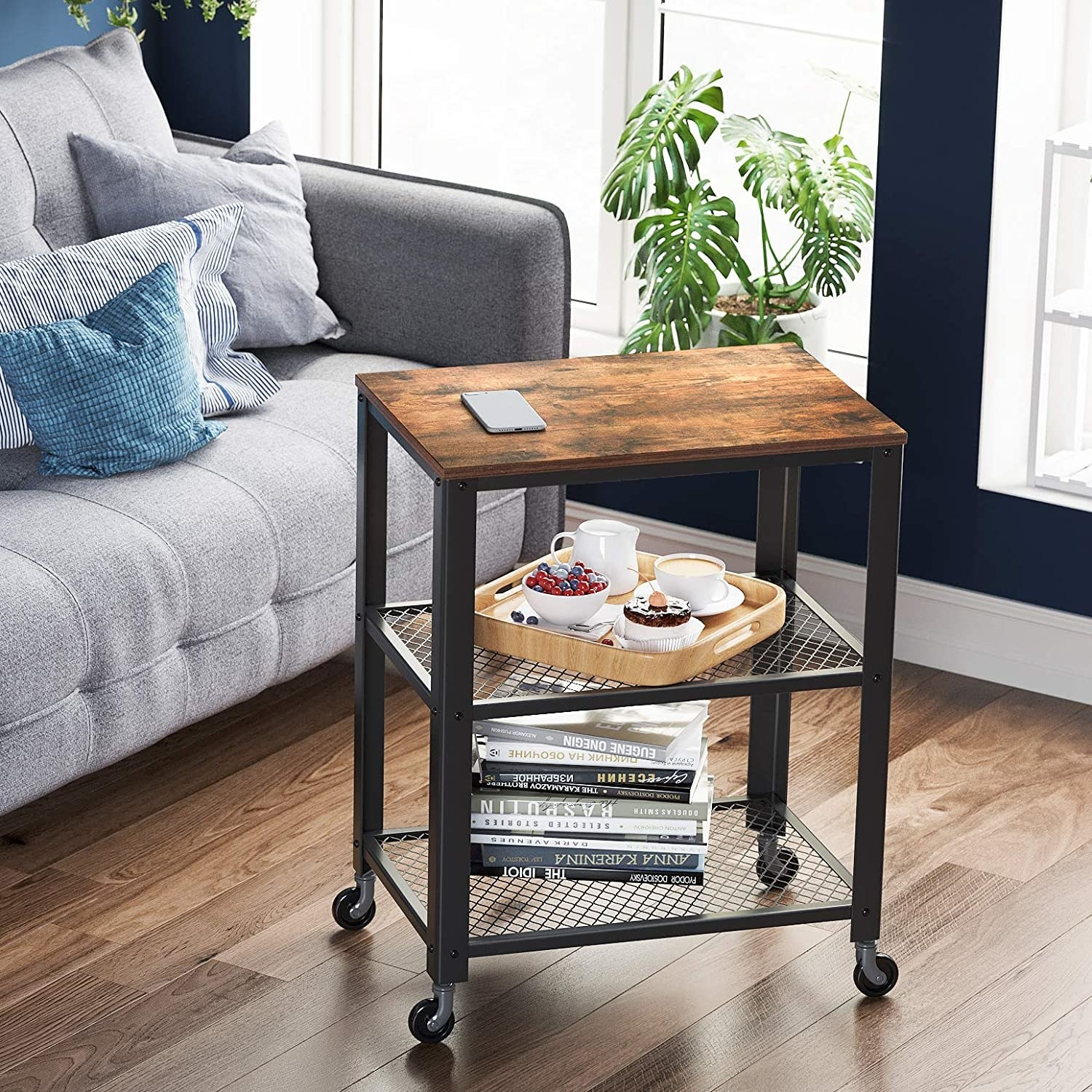 Wooden top bar cart with black body and two metal mesh shelves