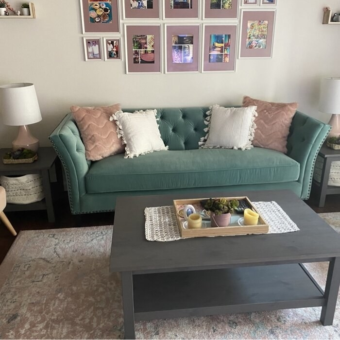 The flare-armed sofa with throw pillows