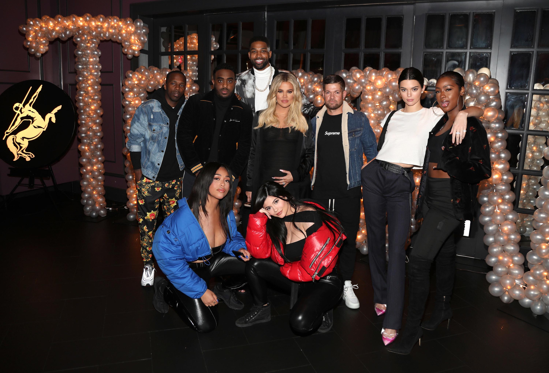 Rich Paul, Simon, Tristan Thompson, Khloe Kardashian, Lucas Newton, Kendall Jenner, Justine Skye, Jordan Woods and Kylie Jenner pose for a photo at Tristan Thompson's birthday party