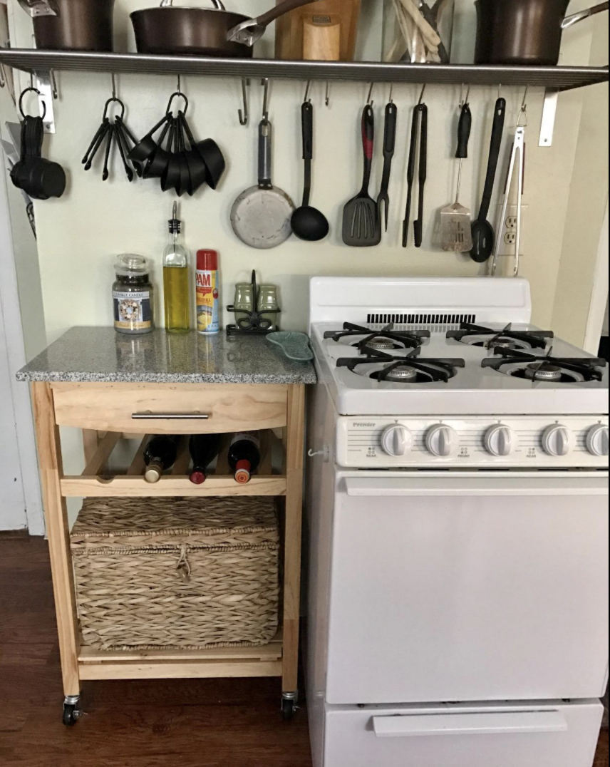 Reviewer's island is next to the stove and is holding kitchen supplies