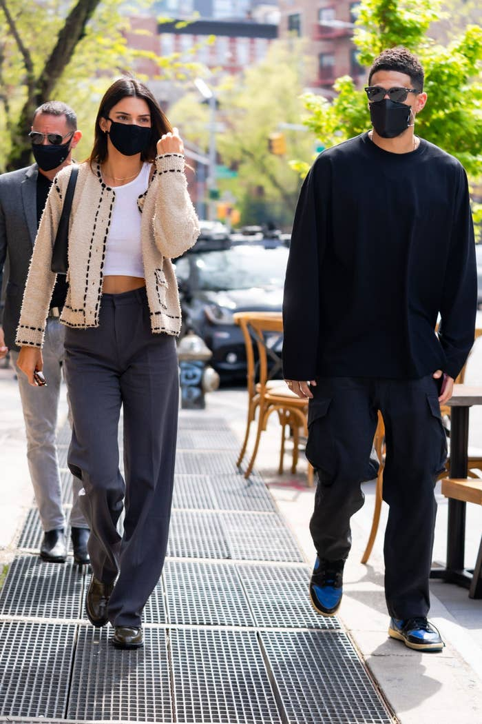Kendall Jenner and Devin Booker walk down the streets of New York while wearing masks