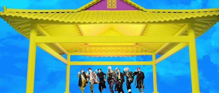BTS dance in sync wearing traditional Korean clothing in the Idol music video