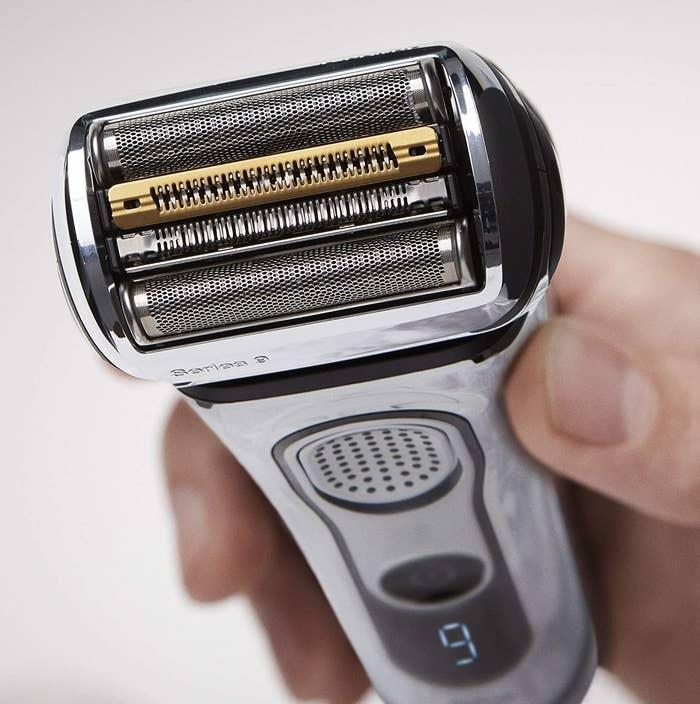 hand holding the electric razor