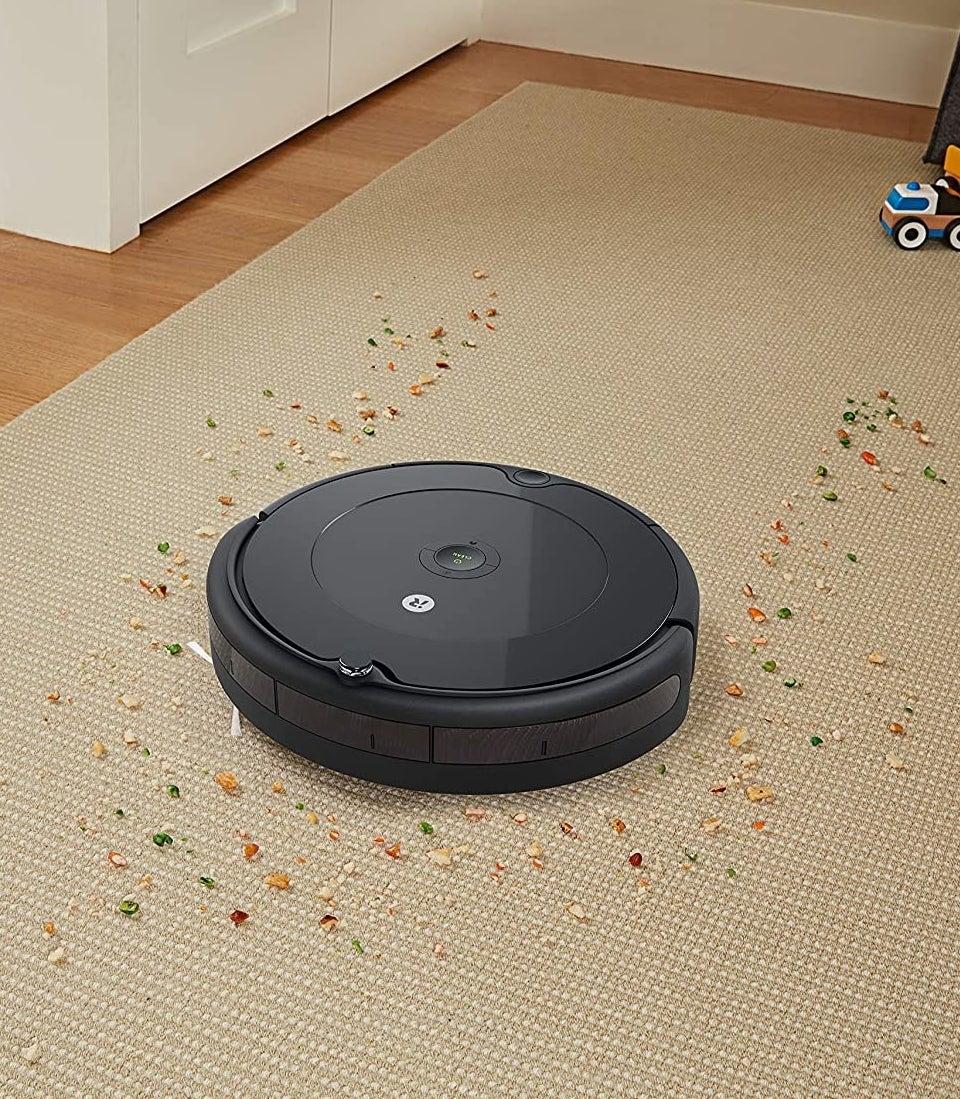 the robot vacuum cleaning up debris