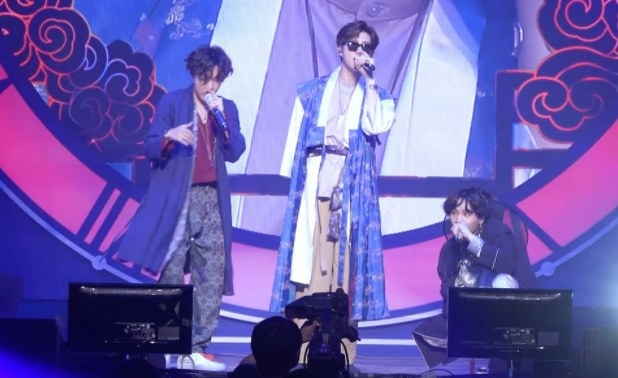 The rap line of BTS wear hanbok and perform onstage