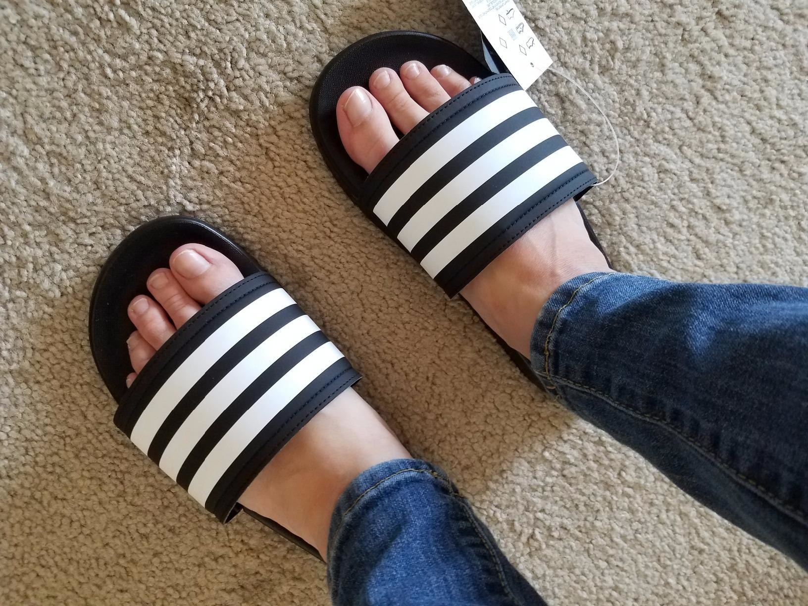 Reviewer photo wearing the black and white striped Adidas slides