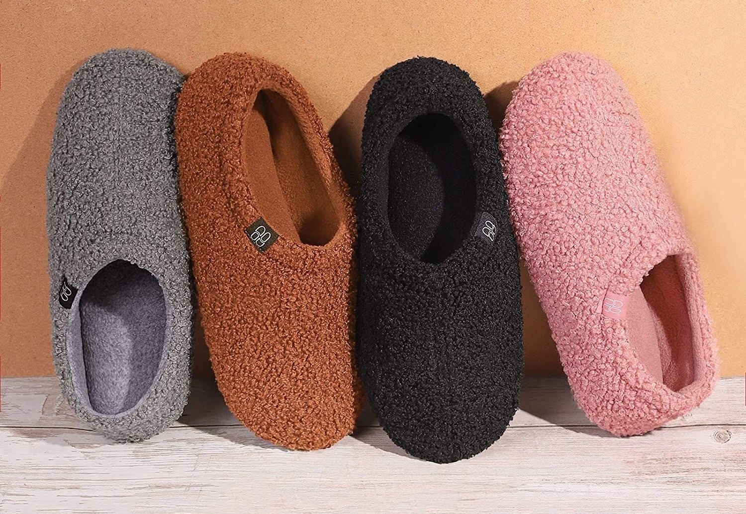 four pairs of different colored fuzzy slippers