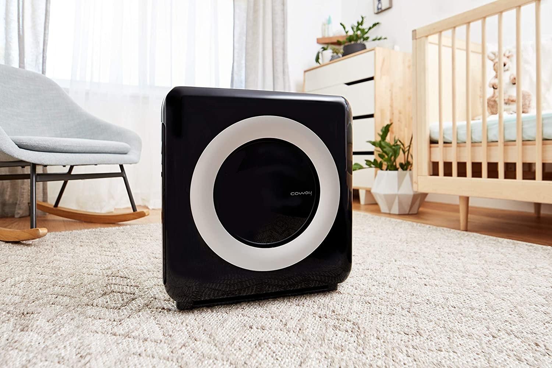 A black square air purifier