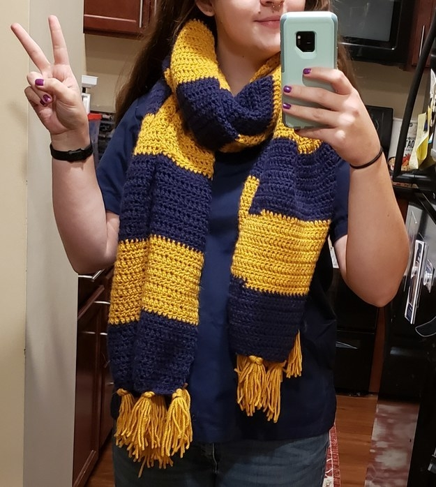 Woman posing with homemade striped scarf