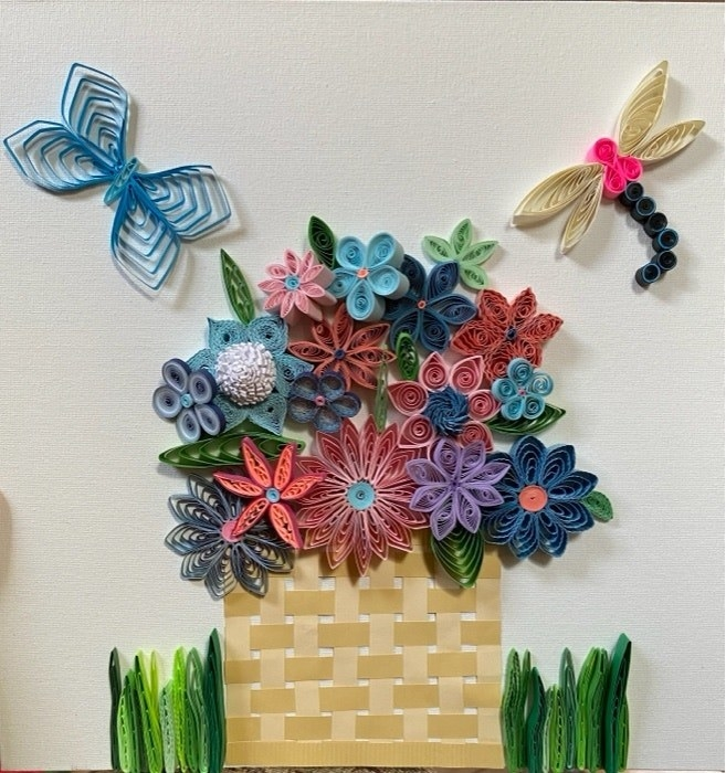 Paper quilled drawing of a basket overflowing with flowers and butterflies