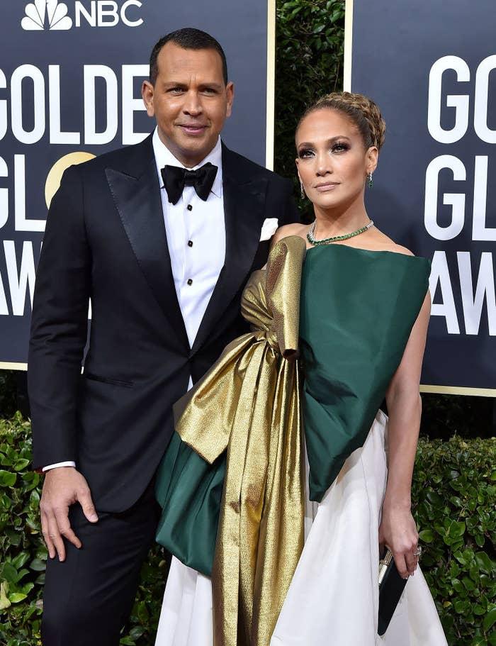 Alex Rodriguez and Jennifer Lopez pose on the Golden Globes red carpet.