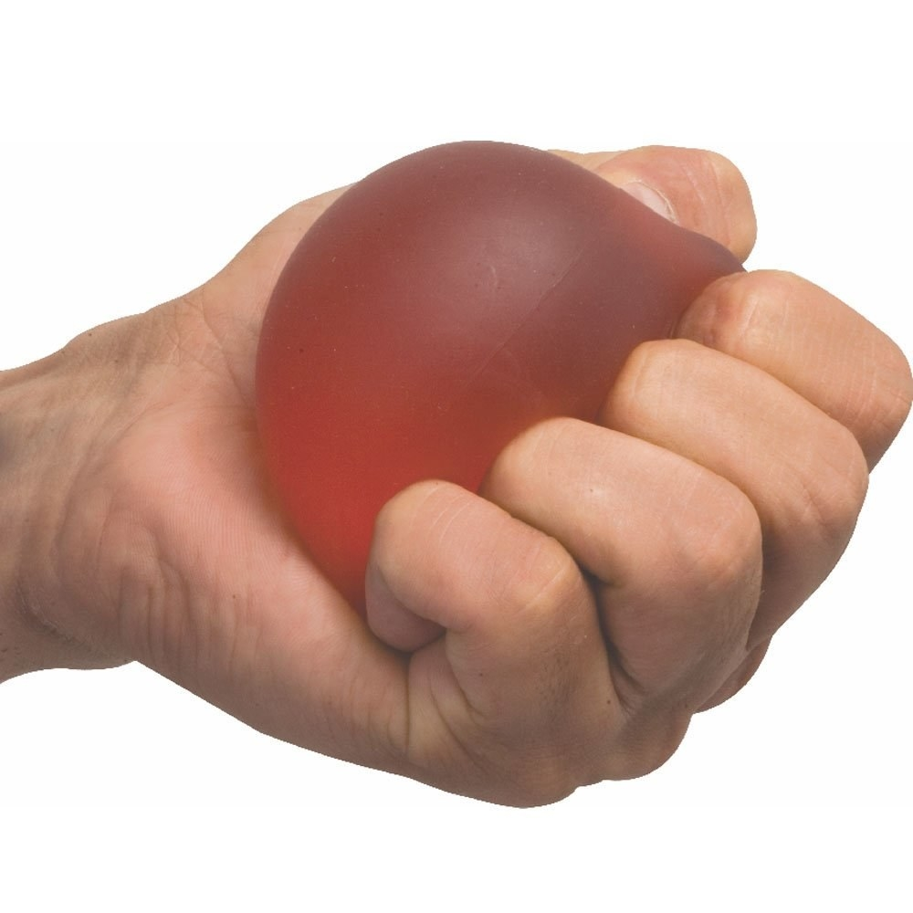 A person squeezing a red gel exercise ball.