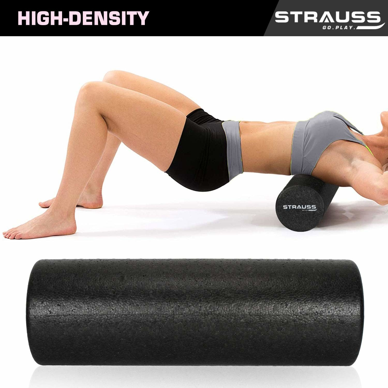 A woman using the cylindrical smooth black foam roller to exercise and relieve stress.