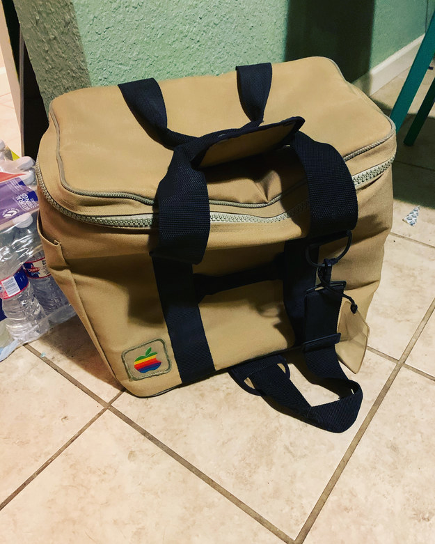 Slouched beige carry-on bag with rainbow Apple logo