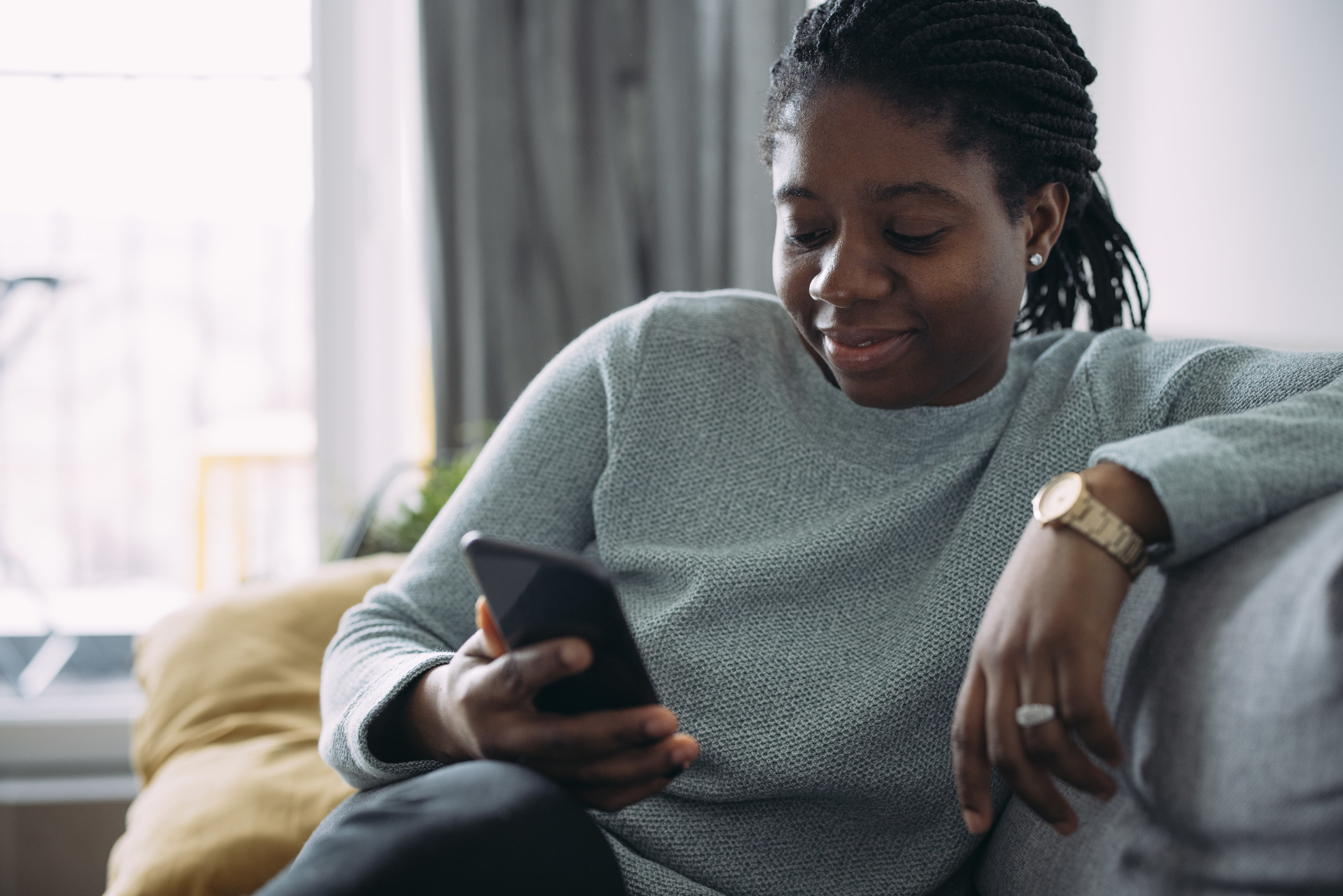 Woman smiles with using an app on her phone