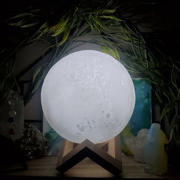 the moon lamp on a wooden stand