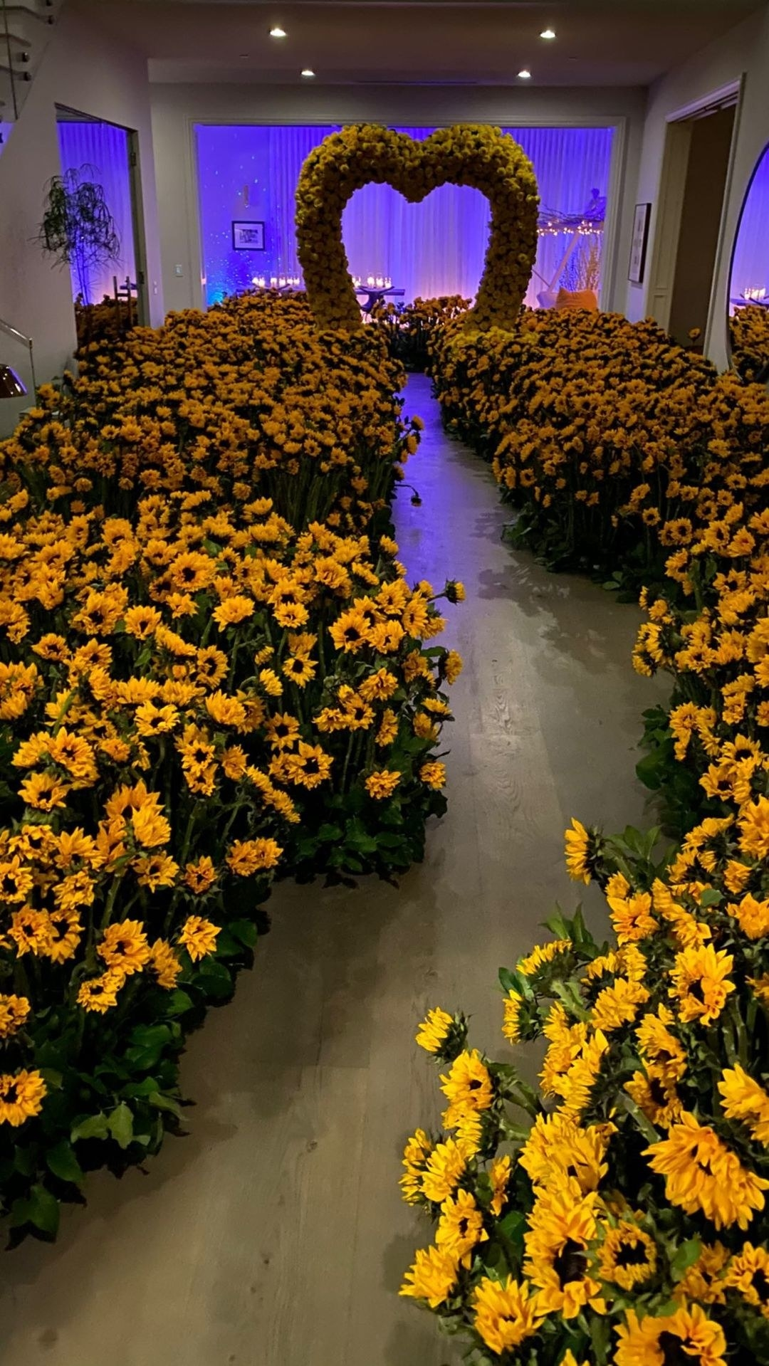 An elaborate sunflower path that leads to a large heart-shaped alter made out of flowers