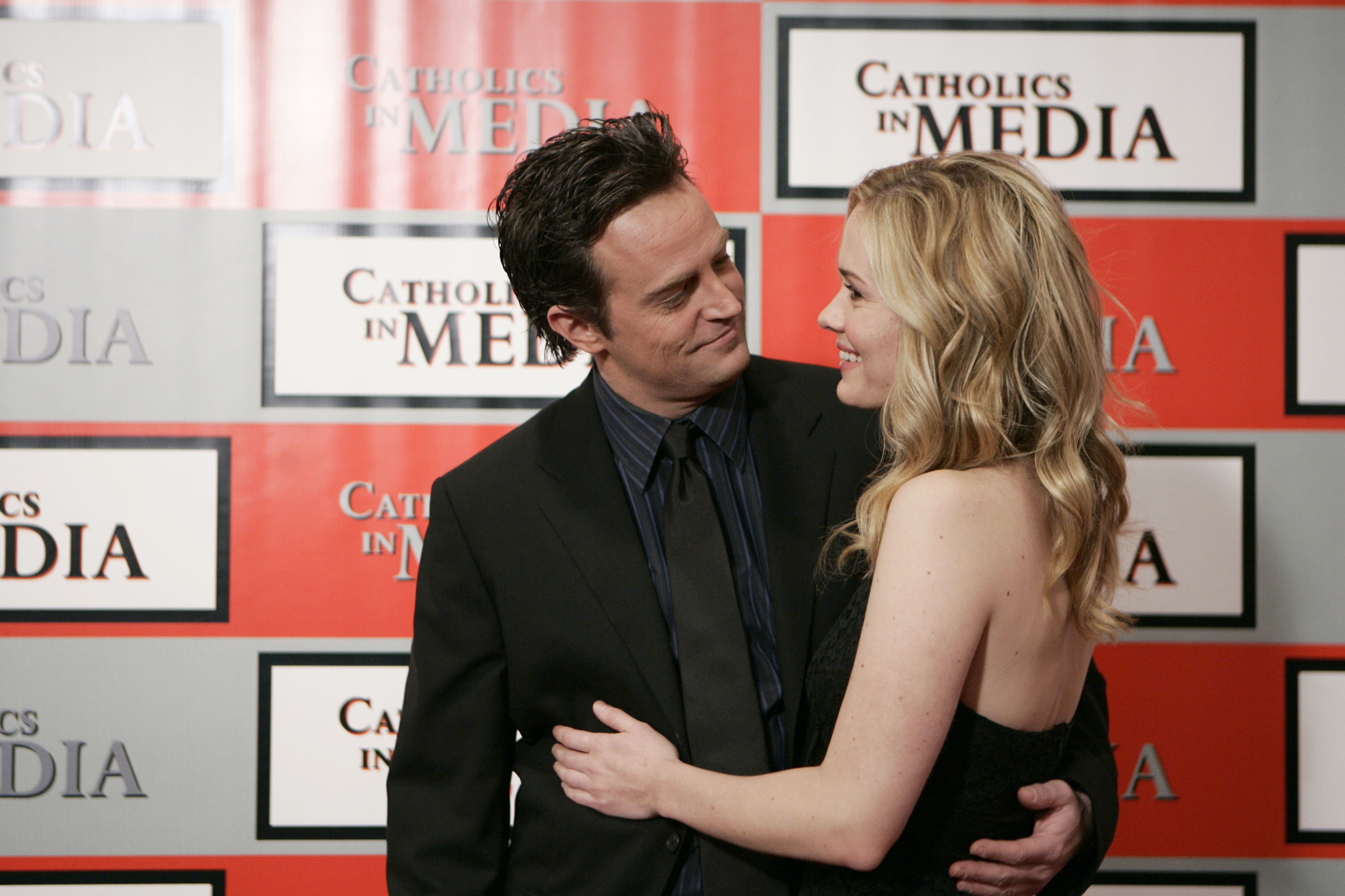 """Matthew Perry and Sarah Paulson embrace in this still image from """"Studio 60 on The Sunset Strip"""""""
