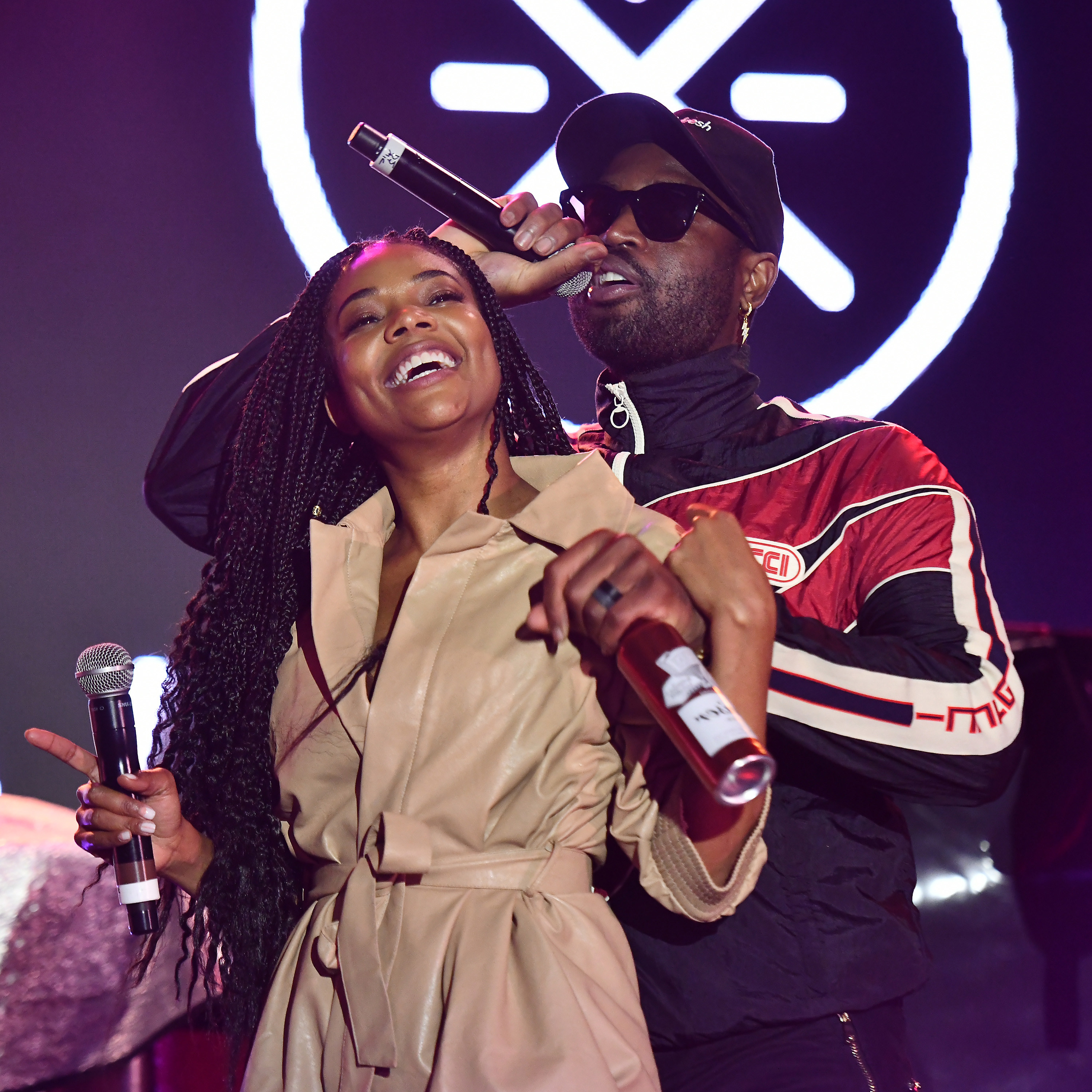 Dwyane Wade and Gabrielle Union perform onstage at ONE37pm x Dwyane Wade's Masters of the Mic Karaoke at Night Two of BUDX Miami by Budweiser on February 01, 2020 in Miami Beach, Florida