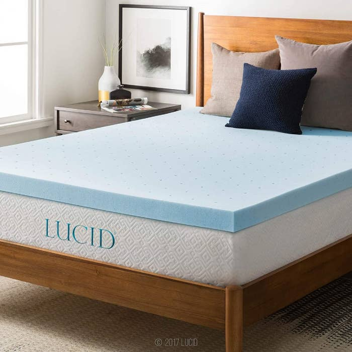 The blue mattress topper on a bed