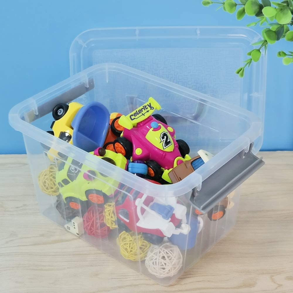 A plastic storage box with toys inside