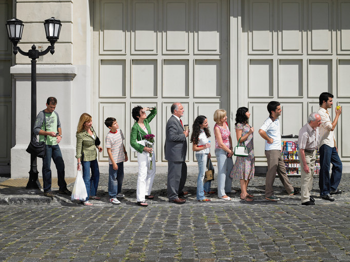Line of people closely standing next to each other