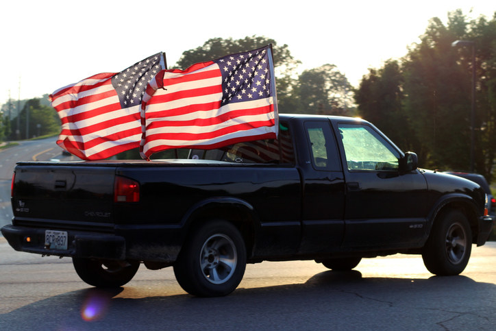 Car with two massive American flags