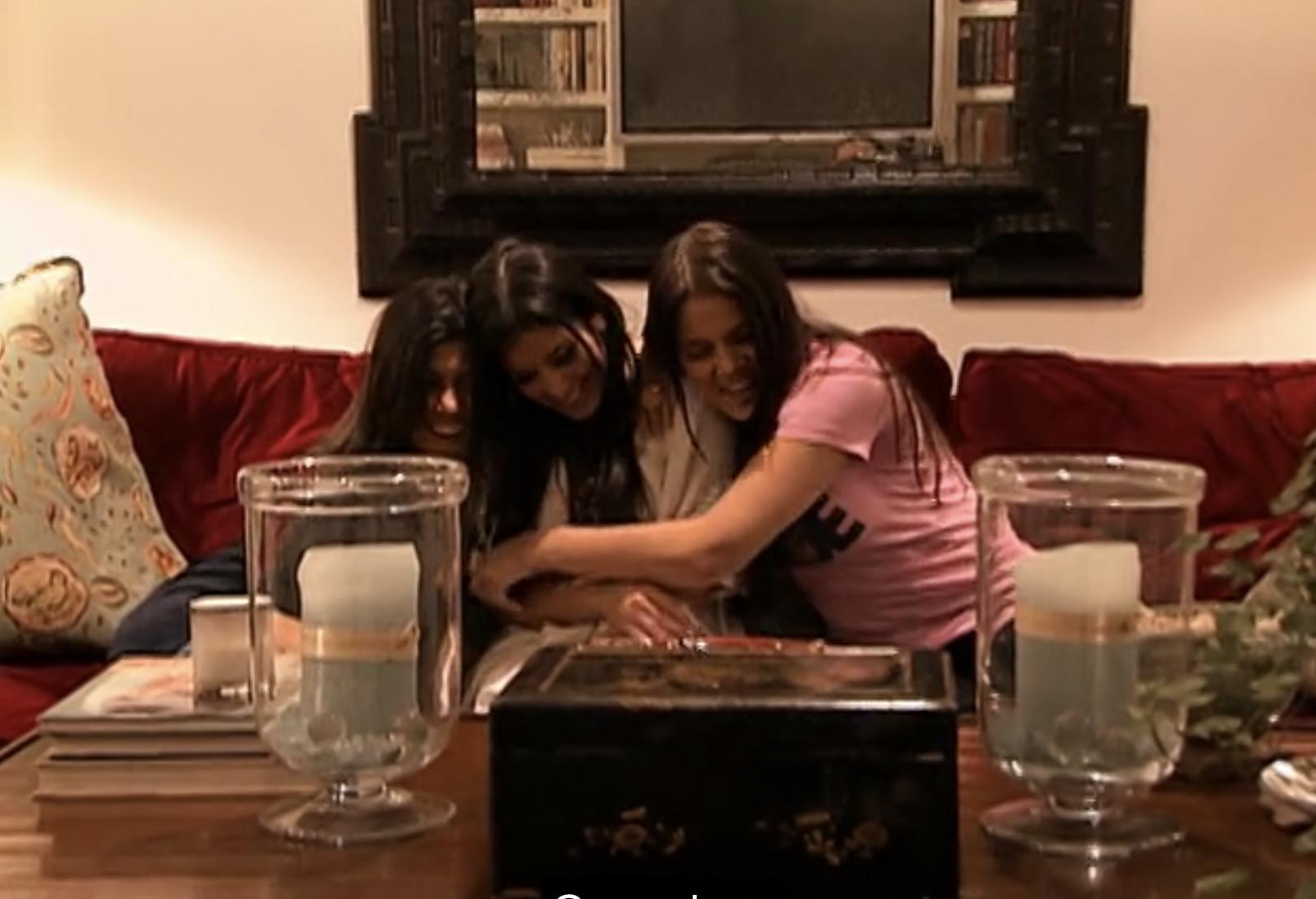 Khloe, Kim, Kourt hugging